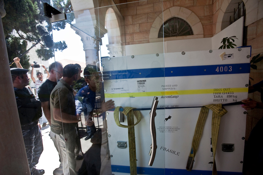 Workers move the Picasso paint to to the International Acadamy of Art of Palestine on June 19, 2011 in Ramallah...Photo by Olivier Fitoussi / Die Zeit