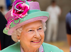 Image ©Licensed to i-Images Picture Agency. 12/06/2014. London, United Kingdom. In the frame - HM The Queen viewing the sports centre. <br /> HM The Queen today officially opens the new Westminster School's sports Centre for Westminster School. HM watched an array of sports including judo, fencing cricket and yoga. Picture by  i-Images