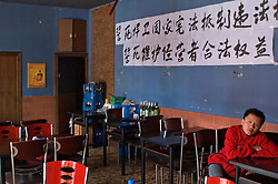 "China, Beijing, Chaoyang, San Jian Fang, 2008. In protest against eviction without compensation, a restaurant closes but refuses to move. The Chinese characters read ""to pledge our lives to protect the constitution and resist illegal demolition, to pledge our lives to maintain businessmen's legal rights."""
