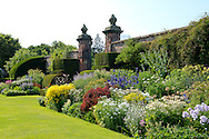 Herbaceous borders and box topiary in the walled garden at Arley Hall, Northwich, Cheshire, UK