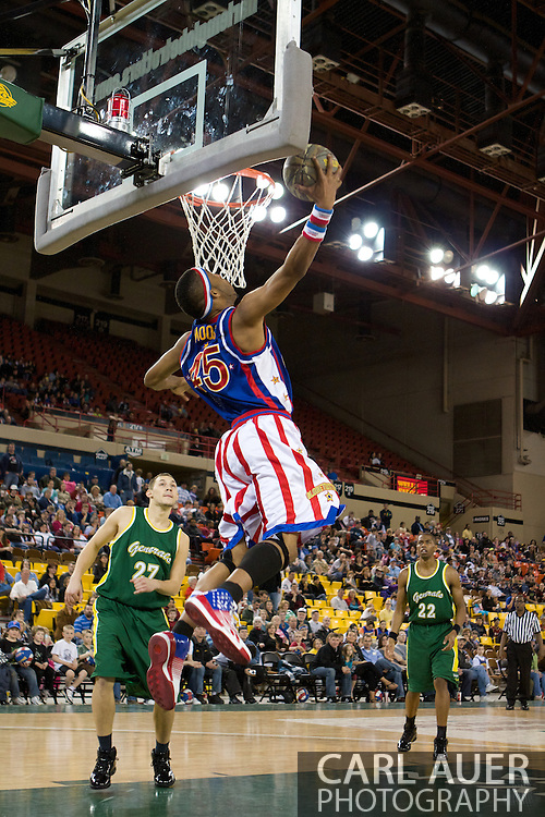 April 30th, 2010 - Anchorage, Alaska:  In a Harlem Globetrotter tribute to the US Armed Forces, Trotter Moose (45) dunks a camo-ball to start the second half against the Washington Generals Friday night at the Sullivan Arena.