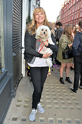 SARA COX with her dog Beano at the Prism Boutique Summer Party held at Prism, 54 Chiltern Street, London on 14th May 2014.