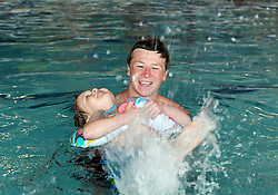 "Mason Moore, 4, has a whale of a time learning to swim under the guidance of instructor Michael Robinson during spring break ""Splash Week"" at the Salinas Community YMCA."