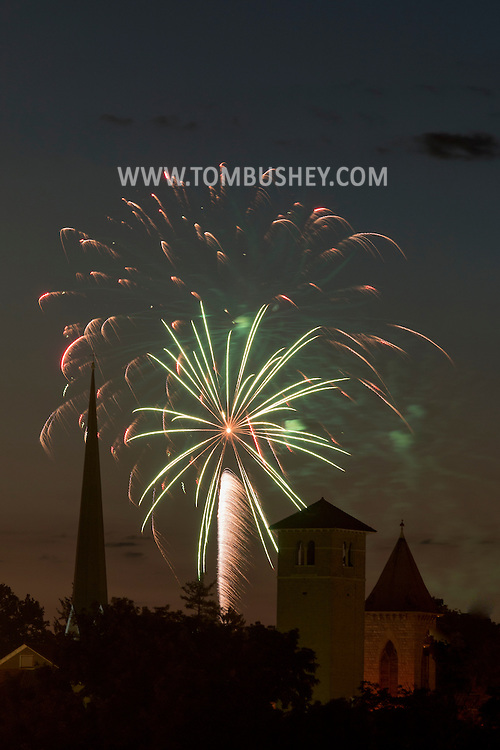 Middletown, New York - Fireworks explode behind church steeples during Middletown's Stars and Striples celebration on July 2, 2016.