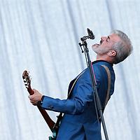 Nederland, Landgraaf, 12 juni 2015<br /> Het optreden van Triggerfinger tijdens de derde dag op het Pinkpopfestival.<br /> Op de foto: Zanger gitarist Ruben Blok tijdens het concert.<br /> <br /> <br /> Foto: Jean-Pierre Jans