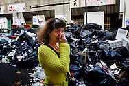 ITALY, NAPLES : A woman walks by piles of uncollected garbage in downtown Naples on May 9, 2011. Garbage has been accumulating on the streets of the the souther italian city for the last weeks. The italian government sent the army in order to face this nes emergency..AFP PHOTO / ROBERTO SALOMONE