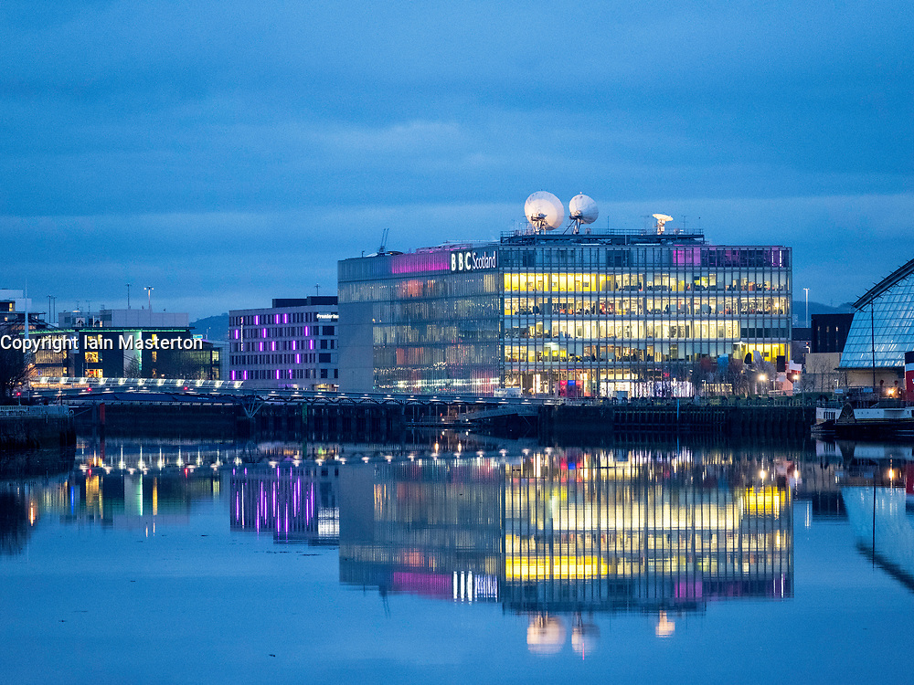 Evening view of BBC Scotland headquarters reflected in River Clyde in Glasgow , Scotland, United Kingdom