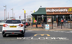 "Livingston During Coronavirus Outbreak, 21 March 2020<br /> <br /> Cafes, pubs and restaurants have been ordered to close, to tackle coronavirus. Nightclubs, theatres, cinemas, gyms and leisure centres must do so ""as soon as they reasonably can"", the government said.<br /> <br /> These steps are part of the UK's social distancing measures.<br /> <br /> Everybody is being asked to avoid non-essential contact with other people.<br /> <br /> Pictured: McDonald's drive-thru was busy as people followed advice for social distancing<br /> <br /> Alex Todd 