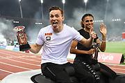 Men and women's 400m hurdles winners, Karsten Warholm (NOR), left, and Sydney McLaughlin (USA) pose IAAF Diamond League championship trophies during the Weltkasse Zurich at Letzigrund Stadium, Thursday, Aug. 29, 2019, in Zurich, Switzerland. (Jiro Mochizuki/Image of Sport)