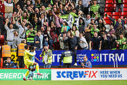 Forest Green Rovers forward Shawn McCoulsky (21) celebrates with Forest Green Rovers goalkeeper Jojo Wollacott (13) after scoring the winning penalty shoot-out goal during the EFL Cup match between Charlton Athletic and Forest Green Rovers at The Valley, London, England on 13 August 2019.