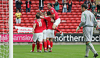 Photo: Paul Thomas.<br /> Barnsley v Southampton. Coca Cola Championship. 19/08/2006.<br /> <br /> Marc Richards and Barnsley celebrate his goal while Southampton keeper Kelvin Davis (R) looks into his net.