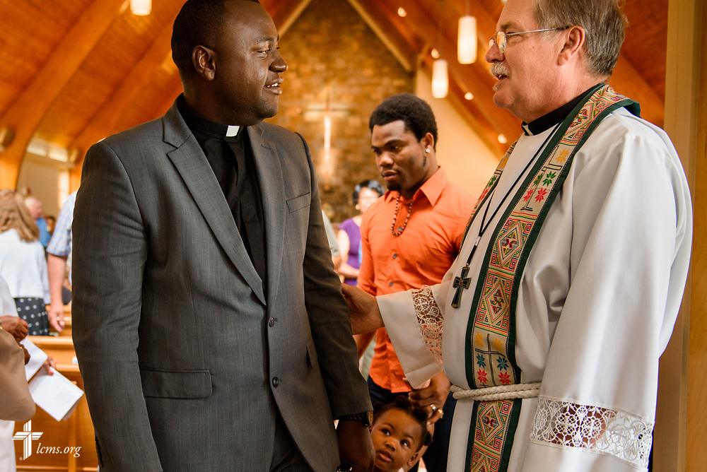 Joseph Lewis, a seminarian in the Ethnic Immigrant Institute of Theology (EIIT) program at Concordia Seminary, St. Louis, greets the Rev. Frederick Hedt III, pastor of Ascension Lutheran Church, Landover Hills, Md., following worship at the church on Sunday, Aug. 6, 2017.  LCMS Communications/Erik M. Lunsford