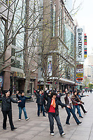 Shanghai, China - April 7, 2013: people exercising on nanjing road at the city of Shanghai in China on april 7th, 2013