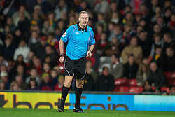 MANCHESTER, ENGLAND - Tuesday, October 26, 2010: Fourth official Kevin Friend swaps roles with the the referee during injury time of the Football League Cup 4th Round match between Manchester United and Wolverhampton Wanderers at Old Trafford. (Pic by: David Rawcliffe/Propaganda)