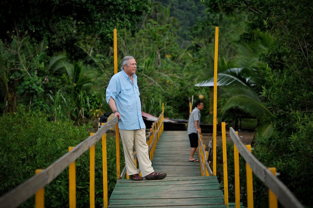 Gordon Radley, 64, (left), watches the river from a bridge in Bahía Solano, located on the northern pacific coast in Chocó, the poorest department of Colombia. Radley, former president of Lucasfilm (Star Wars, Indiana Jones) traveled to Colombia this month as part of his decades-long search for the remains of his brother, Lawrence Radley, a Peace Corps volunteer who died in a plane crash in the Colombian jungle in 1962. Radley promised that he would someday retrace the last steps of his brother, and complete the journey from Bahía Solano to Quibdó, Colombia that his brother died trying to make.