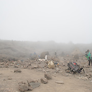 Climbers take a break near Millenium Camp in thick fog on Mt Kilimanjaro.