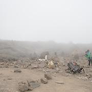 Climbers take a break near Millenium Camp in thick fog on Mt Kilimanjaro.