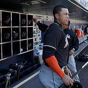 NEW YORK, NEW YORK - APRIL 13: Giancarlo Stanton , Miami Marlins, preparing to bat in the dugout during the Miami Marlins Vs New York Mets MLB regular season ball game at Citi Field on April 13, 2016 in New York City. (Photo by Tim Clayton/Corbis via Getty Images)