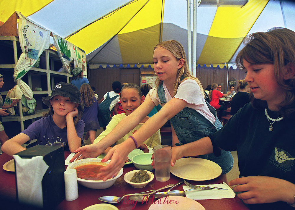 Kayla Amato (cq), 11, serves lunch to her fellow campers and leader at Camp Menzies Girl Scout camp. All the campers share in mealtime chores and post-meal cleanup.  June 28, 2000.