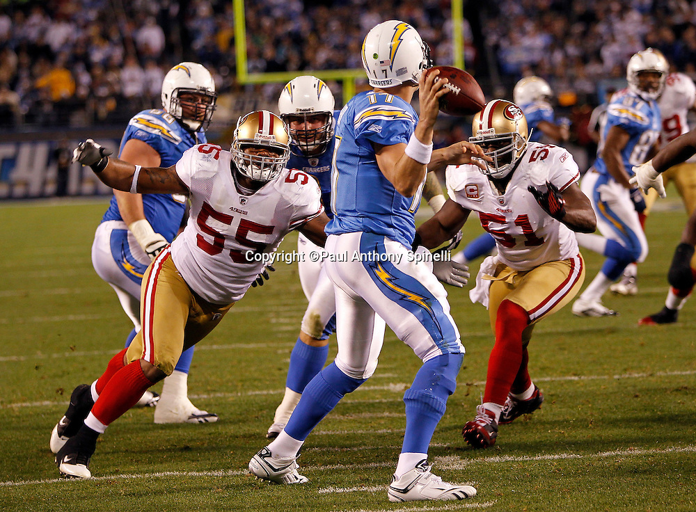 San Diego Chargers quarterback Philip Rivers (17) drops back to pass while pressured by San Francisco 49ers linebacker Ahmad Brooks (55) and San Francisco 49ers linebacker Takeo Spikes (51) during the NFL week 15 football game against the San Francisco 49ers on Thursday, December 16, 2010 in San Diego, California. The Chargers won the game 34-7. (©Paul Anthony Spinelli)