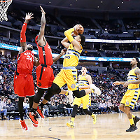 18 November 2016: Denver Nuggets guard Jamal Murray (27) goes to the basket against Toronto Raptors forward Terrence Ross (31) and Toronto Raptors forward Patrick Patterson (54) during the Toronto Raptors 113-111 OT victory over the Denver Nuggets, at the Pepsi Center, Denver, Colorado, USA.