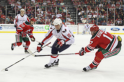Mar 18; Newark, NJ, USA; Washington Capitals right wing Matt Bradley (10) skates with the puck while being defended by New Jersey Devils left wing Ilya Kovalchuk (17) during the third period at the Prudential Center. The Washington Capitals defeated the New Jersey Devils 3-0.
