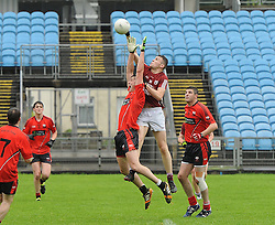 Balla&rsquo;s Barry Duffy gets above Balliycastle&rsquo;s Michael Forde during the county junior semi-final at McHale park.<br />Pic Conor McKeown