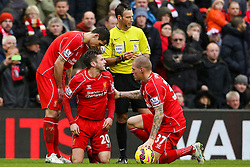 Liverpool's Adam Lallana reacts after being fouled by Manchester City's Wilfried Bony  -  Photo mandatory by-line: Matt McNulty/JMP - Mobile: 07966 386802 - 01/03/2015 - SPORT - Football - Liverpool - Anfield Stadium - Liverpool v Manchester City - Barclays Premier League