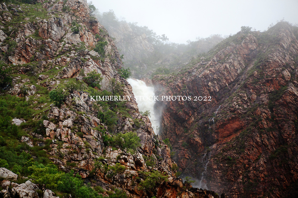 A massive amount of water flows down a waterfall in Talbot Bay in the Kimberley wet season, as the bay is caught between two cyclones.