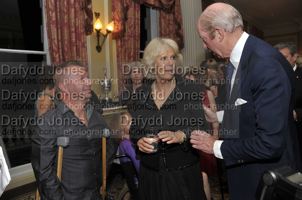 LEE PEARSON; CAMILLA DUCHESS OF CORNWALL; NICHOLAS PETO, , The Lady Joseph Trust, fundraising party.<br /> Camilla, Duchess of Cornwall  attends gala fundraising event as newly appointed President of the charity. The Lady Joseph Trust was formed in 2009 to raise funds to acquire horses for the UK's top Paralympic riders Cavalry and Guards Club, 127 Piccadilly, London,<br /> 26 October 2011. <br /> <br />  , -DO NOT ARCHIVE-© Copyright Photograph by Dafydd Jones. 248 Clapham Rd. London SW9 0PZ. Tel 0207 820 0771. www.dafjones.com.