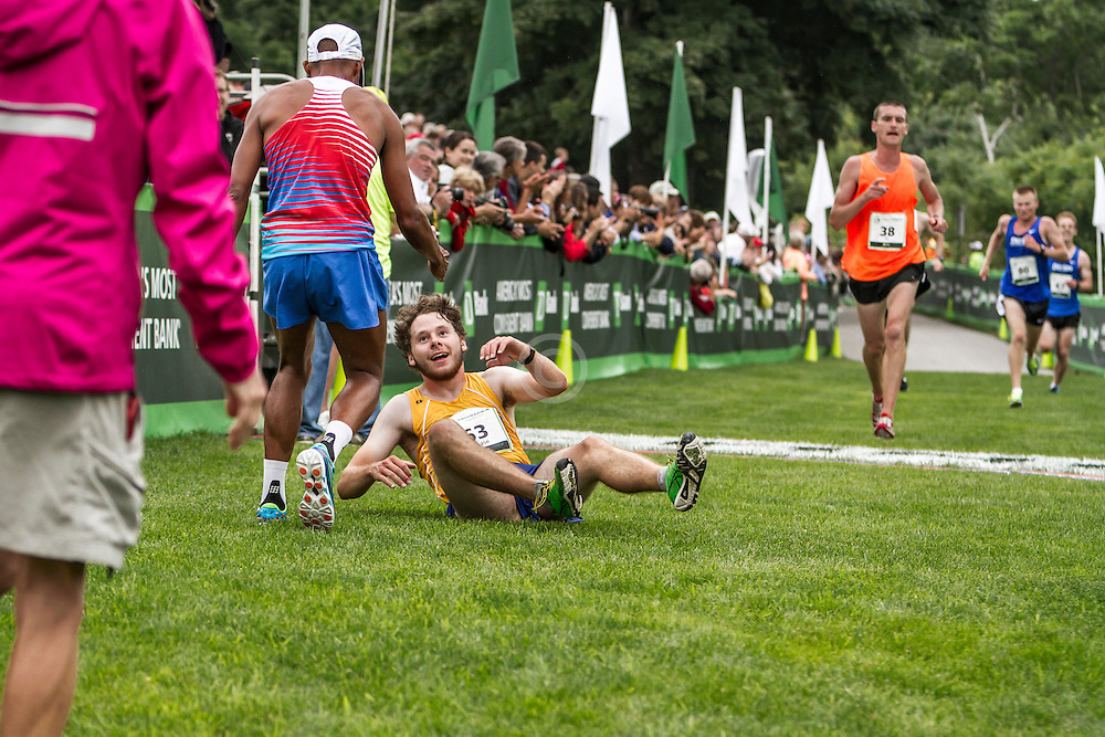 Beach to Beacon 10K: Chase Brown, 20, Boothbay Harbor, Maine, gets help from Olympian Meb Keflezighi after falling after crossing finish line, taking 37th place in race