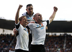 Derby County's Jake Buxton celebrates scoring the first goal with Jamie Ward and Richard Keogh-Photo mandatory by-line: Matt Bunn/JMP - Tel: Mobile: 07966 386802 09/11/2013 - SPORT - FOOTBALL - Pride Park - Derby - Derby County v Sheffield Wednesday - Sky Bet Championship