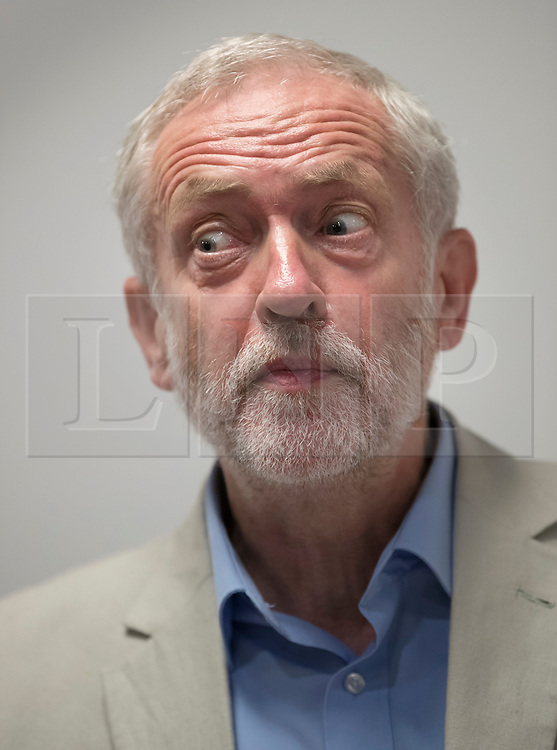 © Licensed to London News Pictures. 24/08/2016. London, UK. Labour party leader Jeremy Corbyn leaves answers journalists questions after speaking on HNS issues. Mr Corbyn faces increasing criticism after appearingng in a video sitting on the floor of a crowded train.  Virgin trains owner Sir Richard Branson released cctv footage appearing to show that seats were available. Photo credit: Peter Macdiarmid/LNP