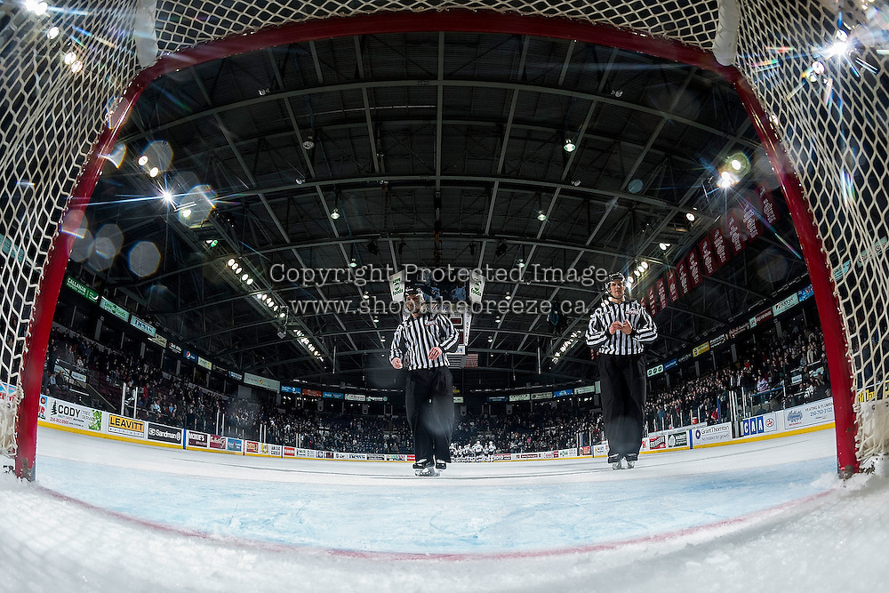 KELOWNA, CANADA - MARCH 4: Linesmen Travis Gawryletz and Dustin Minty exit the ice at the Kelowna Rockets against the Tri-City Americans on March 4, 2017 at Prospera Place in Kelowna, British Columbia, Canada.  (Photo by Marissa Baecker/Shoot the Breeze)  *** Local Caption ***