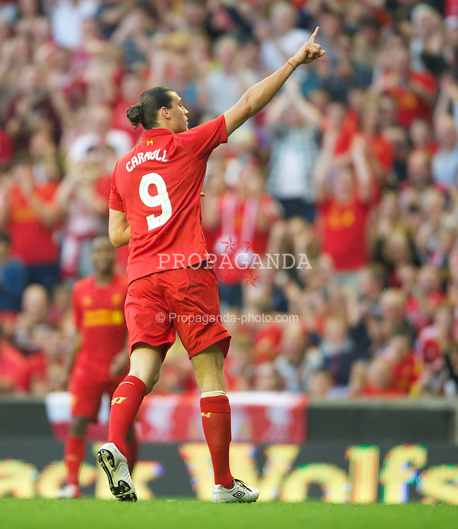 LIVERPOOL, ENGLAND - Sunday, August 12, 2012: Liverpool's Andy Carroll celebrates scoring the third goal against Bayer 04 Leverkusen during a preseason friendly match at Anfield. (Pic by David Rawcliffe/Propaganda)