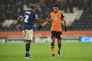 Hull City striker Chuba Akpom and Bolton Wanderers defender Prince-Desire Gouano touch hands after rough tackel during the Sky Bet Championship match between Hull City and Bolton Wanderers at the KC Stadium, Kingston upon Hull, England on 12 December 2015. Photo by Ian Lyall.
