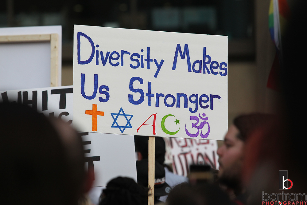 Signs supporting diversity and unity are displayed during an anti white-supremacy rally at Dallas City Hall plaza on Saturday, Aug. 19, 2017. (Photo by Kevin Bartram)