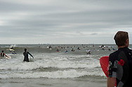 20110911 - Long Beach , NY - Surfers, made up of police, fire fighters, military, and local and pro surfers enter the water during a paddle out in remembrance of 9/11 as part of a beach mass and ecumenical service at National Boulevard Beach.  .Photo by Isabel Slepoy / LI Herald