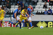 AFC Wimbledon striker Lyle Taylor (33) and Rochdale FC defender Harrison McGahey (6) during the EFL Sky Bet League 1 match between Rochdale and AFC Wimbledon at Spotland, Rochdale, England on 27 August 2016. Photo by Stuart Butcher.
