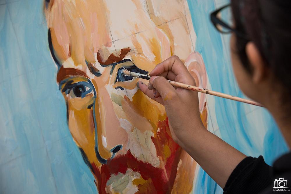 San Jose State University pictorial arts student Monica Gonzalez (Class of 2014) paints a portrait of Vincent van Gogh during Humanities & Arts Day Student Showcase at San Jose State University's Student Union Barrett Ballroom in San Jose, California, on October 25, 2013. (Stan Olszewski/SOSKIphoto)