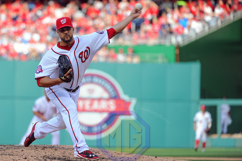 Washington Nationals relief pitcher Xavier Cedeno (29) pitches against the New York Mets in the 8th inning on opening day at Nationals Park in Washington, D.C. on April 6, 2015 where the New York Mets defeated the Washington Nationals, 3-1.   Photo by Mark Goldman/UPI
