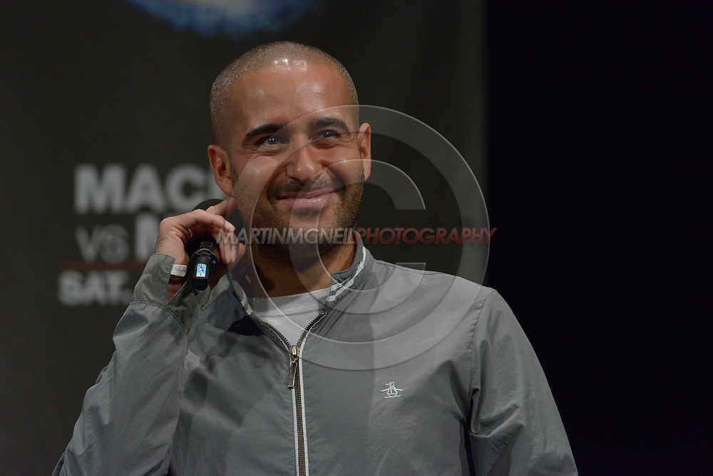 """MANCHESTER, ENGLAND, NOVEMBER 25, 2013: Jon Anik hosts a fan Q&A session ahead of the official weigh-in for """"UFC Fight Night 30: Machida vs. Munoz"""" inside Mancheter Central Convention Center in Manchester, England (Martin McNeil for ESPN)"""