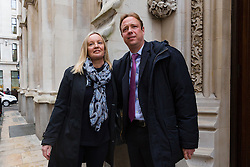© Licensed to London News Pictures. 27/02/2017. LONDON, UK.  Gabby (Gabrielle) and Florian Kuehn arrive at Mayor's and City of London court in London for the verdict of a case against their property management company, Victory Place. Gabby and Florian Kuehnn from Limehouse in east London claim they were told their pet dog, a Yorkshire terrier cross, Vinnie could live in their flat when they purchased it, but the management firm, Victory Place has subsequently insisted it has has a blanket no-pets policy. The animal rescue charity, All Dogs Matter are backing the couple and says no-pet rules see thousands of pets dumped each year and the rules are particularly unfair on the elderly and vulnerable who rely on pets for support and companionship. Photo credit: Vickie Flores/LNP