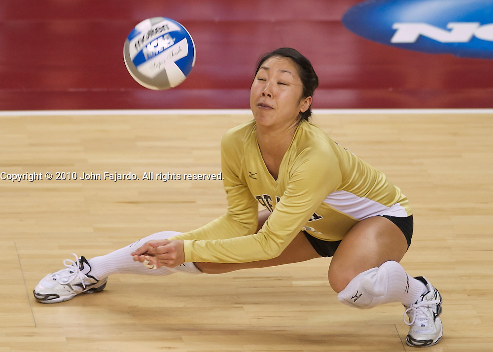 Ashley Lee tries to keep the ball in play in the first round match against University of San Diego in the 2010 NCAA Women's Volleyball Tournament at the Galen Center, Los Angeles, Calif., Friday, Dec. 3, 2010