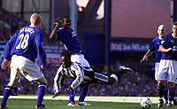 Photo Aidan Ellis.<br />Everton v Newcastle United.<br />FA Barclaycard Premiership.<br />13/09/2003.<br />Newcastle's Olivier Bernard is brought down by Everton's Joseph Yobo for the second penalty