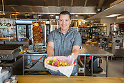 BENTONVILLE, AR - FEBRUARY 15:  Rafael Rios displays a assortment of Mexican Street Tacos from Yeyo's Mexican Grill at the 8th Street Market in Bentonville, Arkansas.<br /> CREDIT Wesley Hitt for The Wall Street Journal<br /> WALMART-Bentonville Scene-setters