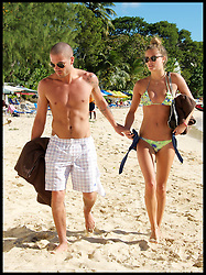 The Wanted's Max George is seen with bikini-clad girlfriend Nina Agdal on a beach in Barbados. Friday, 29th November 2013. Picture by Nils Jorgensen / i-Images