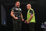 Gerwyn Price beats Michael van Gerwin to reach the final during the Grand Slam of Darts, at Aldersley Leisure Village, Wolverhampton, United Kingdom on 17 November 2019.