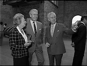 10/09/1988<br /> 09/10/1988<br /> 10 September 1988<br /> ROSC 1988 Exhibition at the Guinness Hop Store. <br /> Sir Norman Mcfarlane visits ROSC '88. Mr Pat Murphy, (right) Chairman of ROSC, shows the exhibition to Sir Norman Macfarlane, Chairman of Guinness plc and Lady Gretta Macfarlane during their visit to ROSC '88.