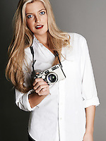 Pretty blonde girl holding camera